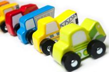 Closeup Of Miniature Toys Alig...