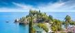 Leinwandbild Motiv Beautiful Isola Bella, small island near Taormina, Sicily, Italy. Narrow path connects island to mainland Taormina beach surrounded by azure waters of Ionian Sea.