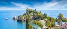 Beautiful Isola Bella, Small Island Near Taormina, Sicily, Italy. Narrow Path Connects Island To Mainland Taormina Beach Surrounded By Azure Waters Of Ionian Sea.