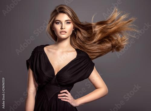 Valokuvatapetti Woman with beauty long brown hair.