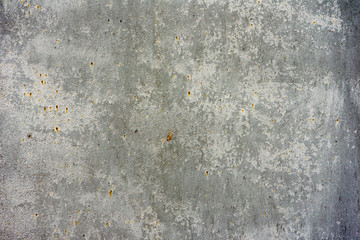 Texture of a concrete wall with cracks and scratches which can be used as a b...