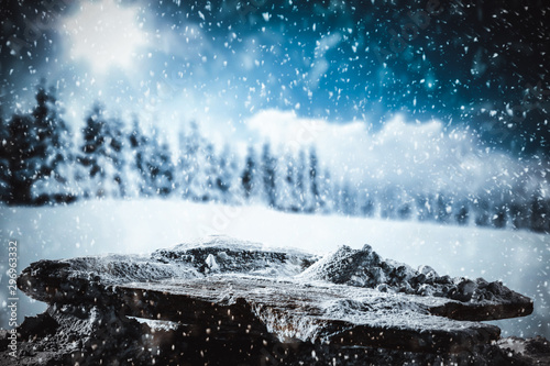 Foto auf AluDibond Grau Verkehrs Snowy winter sunshine landscape with wooden board top for products and decorations.