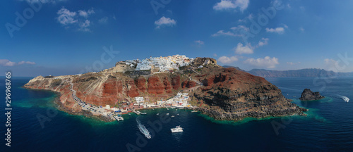 Fototapeta Aerial drone panoramic photo of traditional and picturesque village of Oia in volcanic island of Santorini, Cyclades, Greece obraz