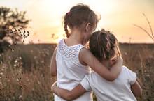 Two Little Sisters In A Field ...