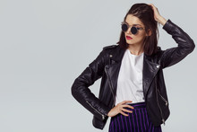 Fashion Portrait Of A Young Woman In Leather Jacket.