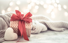 Background Holiday, Gift In A Beautiful Box With A Heart .