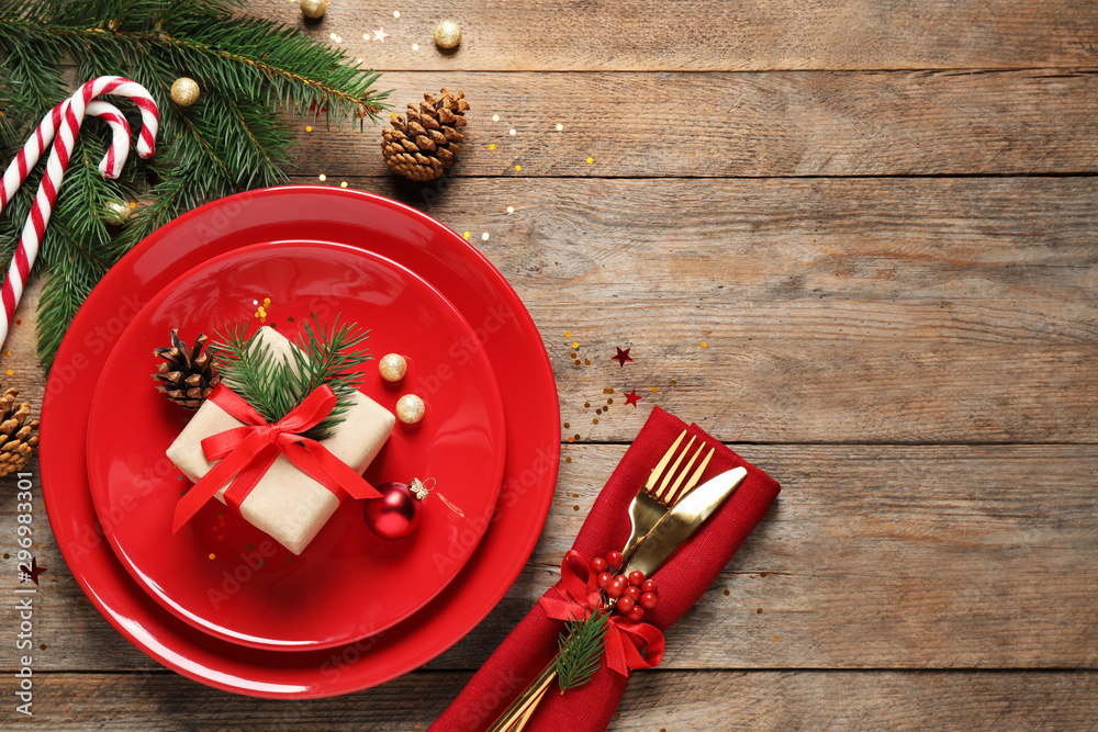 Fototapety, obrazy: Beautiful Christmas table setting on wooden background, top view. Space for text