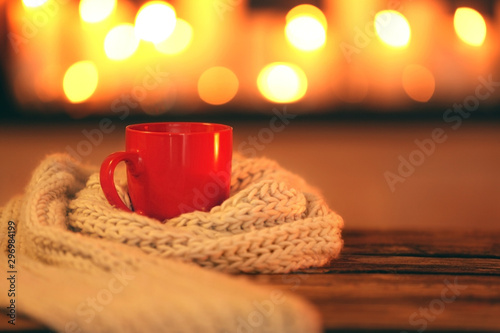 Recess Fitting Tea Cup of hot drink on wooden table against blurred background, space for text. Winter atmosphere
