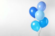 Bunch Of Blue Balloons On Whit...