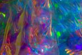 Fototapeta Tęcza - close up holographic plastic bag blurred transparent texture