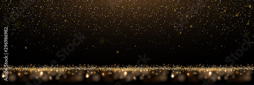 Obraz Gold glitter and shiny golden rain on black background. Vector horizontal luxury background. - fototapety do salonu