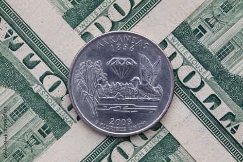 Fototapeta Symmetric composition of US dollar bills and a quarter of Arkansas
