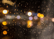 Drops Of Night Rain On Window, On Back Plan Washed Away Lights Of The Torches. Shallow DOF.Drops Of Rain On Blue Glass Background. Street Bokeh Lights Out Of Focus. Autumn Abstract Backdrop