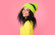 Here You Are! Glorious African American Girl In A Yellow Sweatshirt And A Green Hat With A Pompom Is Posing In Profile, Smiling, Her Head Turned To The Camera.