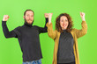 canvas print picture - Beautiful young couple over green background celebrating surprised and amazed for success with arms raised. Winner concept.