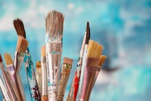 Paint Brushes In Front Of Blur...