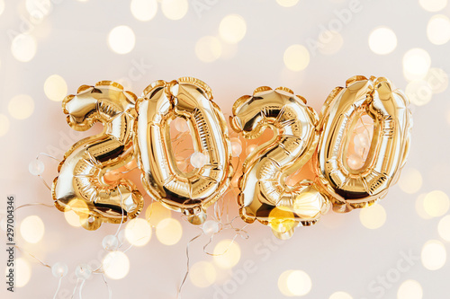 Poster Fleur Foil balloons in the form of numbers 2020. New year celebration. Gold and silver Air Balloons. Holiday party decoration.