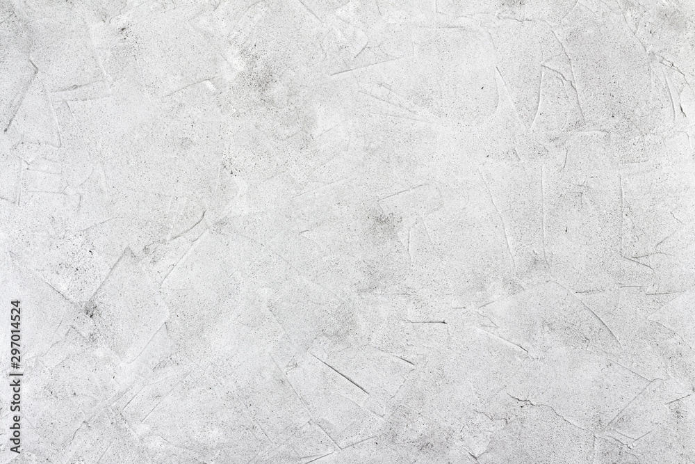 Fototapeta Abstract concrete background - in the form of a rough covered with folds wall, closeup