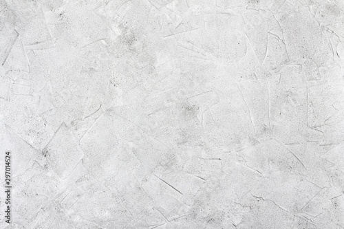 Abstract concrete background - in the form of a rough covered with folds wall, closeup - 297014524