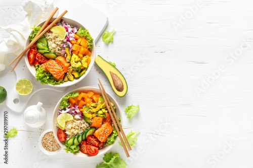 Buddha bowl with grilled salmon fish, fresh cucumber, tomato, onion, sweet peppe Fototapeta