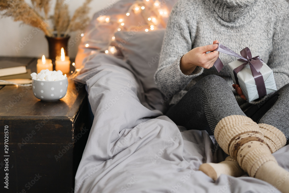 Fototapety, obrazy: Woman holding gift in cozy room. Merry Christmas!