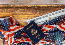 USA Passport And Naturalization Certificate Of Citizenship US Flag Over Wooden Background