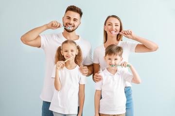 Portrait of family brushing...