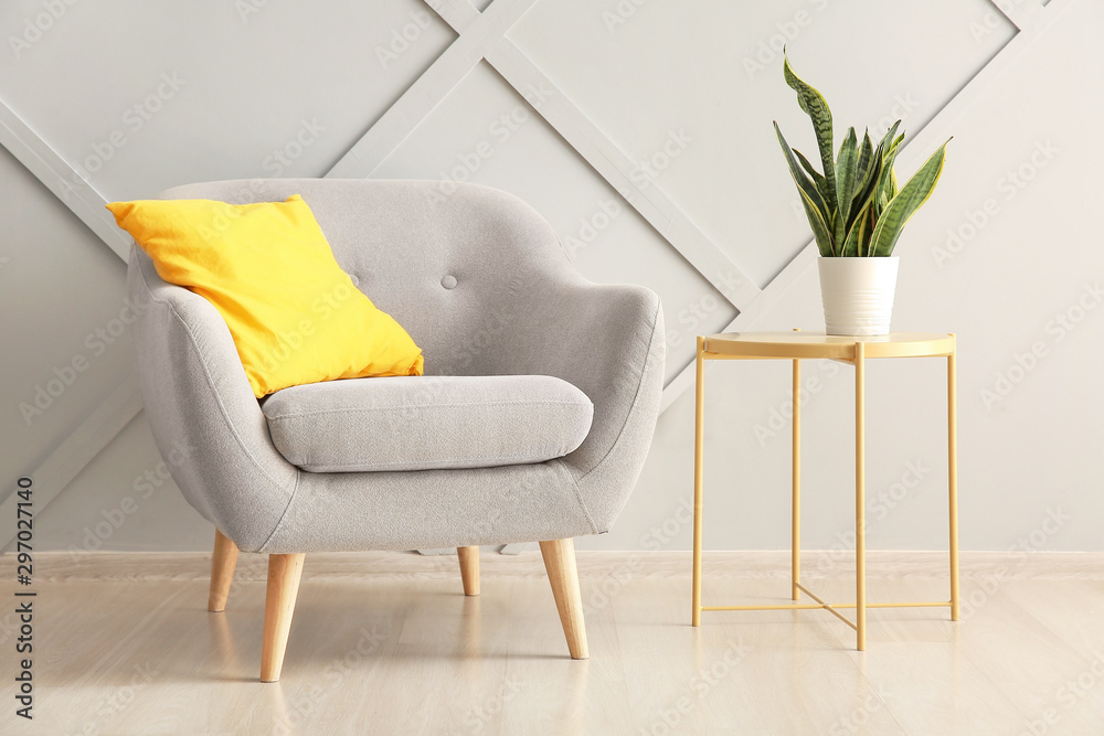 Fototapety, obrazy: Armchair and table near light wall in room