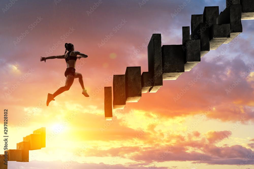 Fototapeta Jumping over precipice, challenge concept.