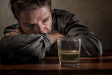 Desperate Alcoholic Man . Depressed Addict Isolated In Front Of Whiskey Glass Trying Not Drinking In Dramatic Expression Suffering Alcoholism And Alcohol Addiction Problem