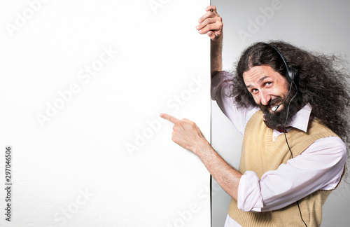 Portrait of a nerdy telemarketer pointing on an empty board Fotobehang