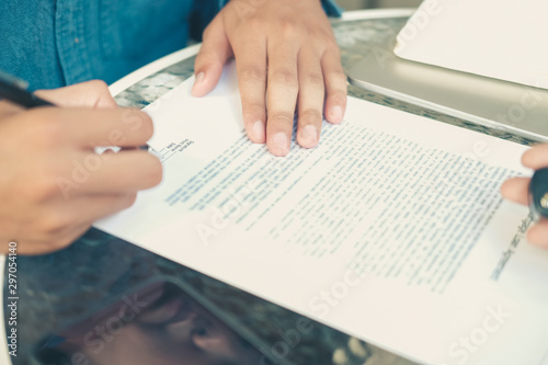 Fototapety, obrazy: businessman signing mortgage loan contract agreement for buying home