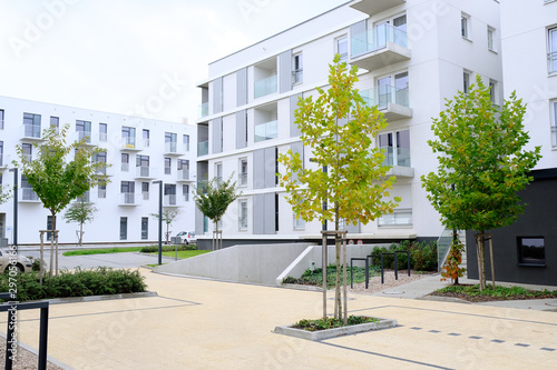 Sidewalk in a cozy courtyard of modern apartment buildings condo with white walls Fotobehang