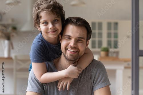 Head shot portrait happy father piggybacking cute little son Canvas-taulu