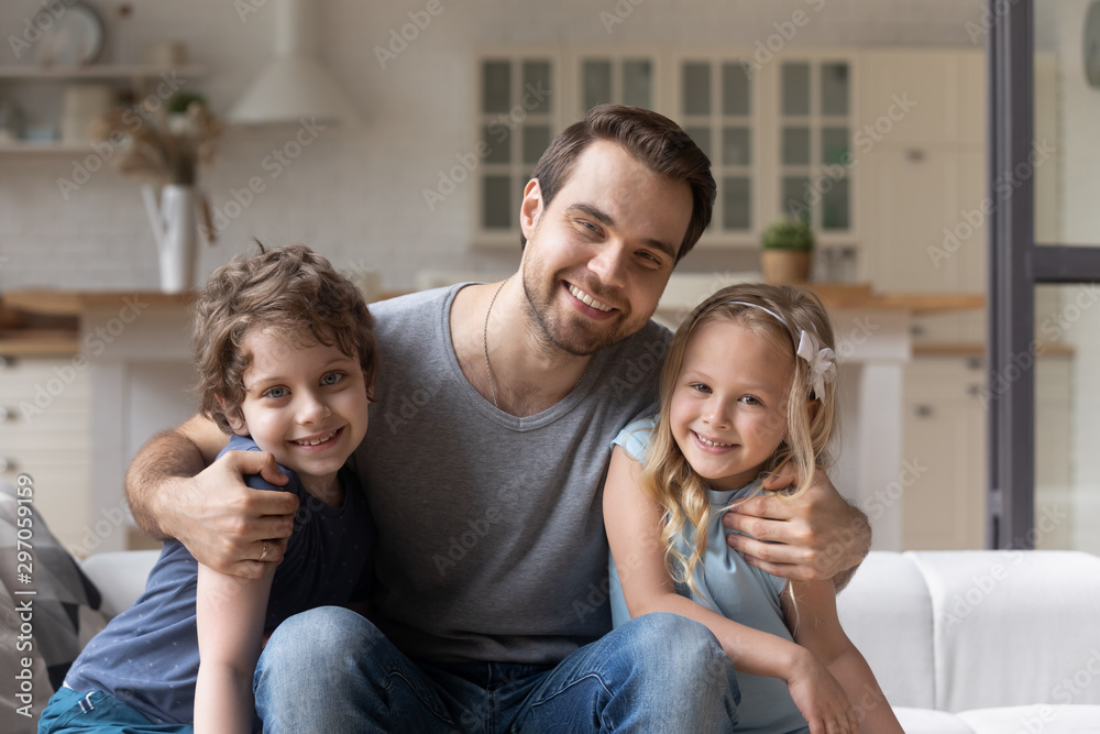 Fototapety, obrazy: Portrait smiling father with adorable son and daughter at home
