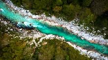 Turquoise Emerald Soca River In Soca Valley,Slovenia. Top Down Drone View