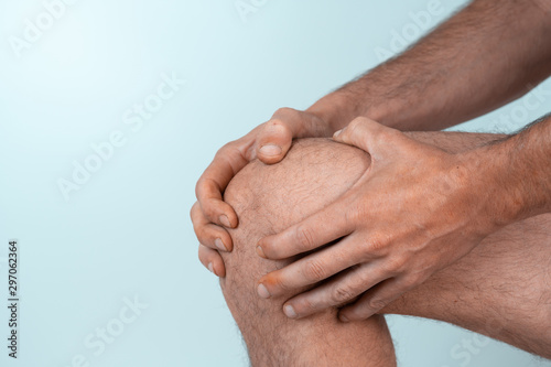 caucasian man with hands on knee in White background space for text Obraz na płótnie