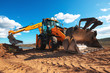 canvas print picture - Wheel loader excavator with field background during earthmoving work, construction building