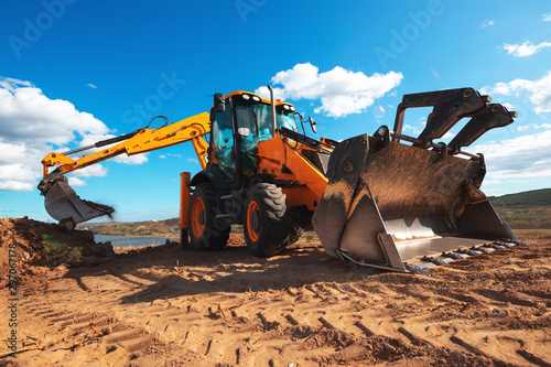 Wheel loader excavator with field background during earthmoving work, constructi Obraz na płótnie