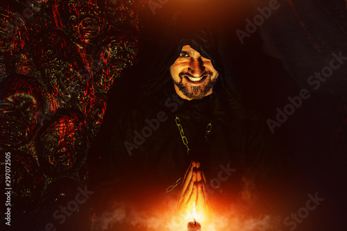 Obraz na płótnie Praying monk near the wall with bloody faces.