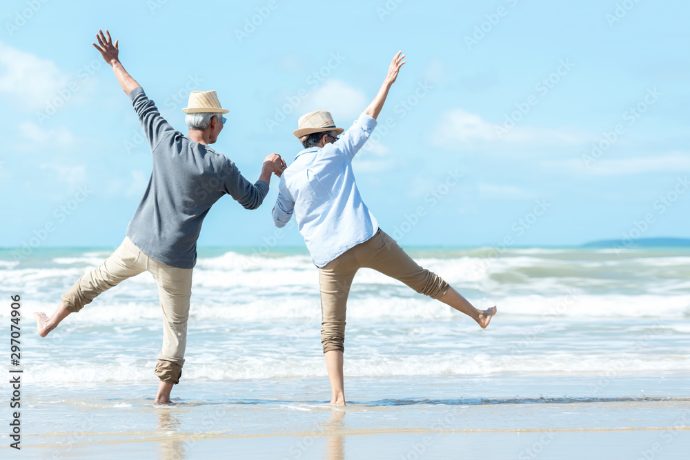 Fototapety, obrazy: Asian Lifestyle senior couple jumping on the beach happy in love romantic and relax time. Tourism elderly family travel leisure and activity after retirement in vacations and summer.