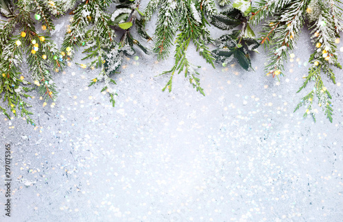 Autocollant pour porte Vegetal Christmas or winter background with a border of green and frosted evergreen branches on a grey vintage board. Flat lay