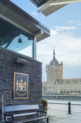 Photo The Seal of The City of Albany or The coat of arms of Albany, which is the heraldic symbol representing the city of Albany (Assiduity) in Forground and the D&H bUilding in Background