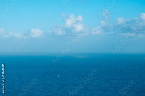 Fotomural sailing boat far away on ocaen horizon, seascape aerial