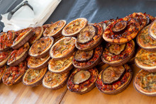 Variety Of Vegetarian Quiches On Display On A Market Stall