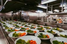Many Plates With Salad. Prepar...