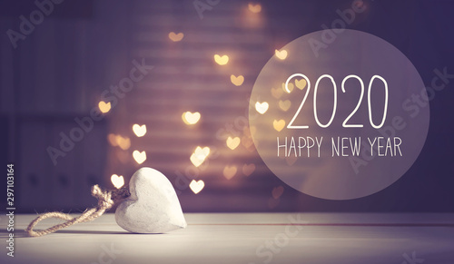 Valokuva  New Year 2020 message with a white heart with heart shaped lights