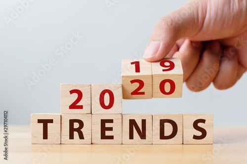 Cuadros en Lienzo 2020 trend concept. Hand flip wood cube change year 2019 to 2020