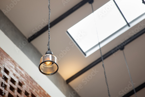 Staande foto Retro Hanging vintage ceiling yellow lamp interior at day light.