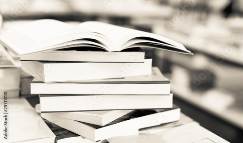 Photo stack of books lying on table in bookstore